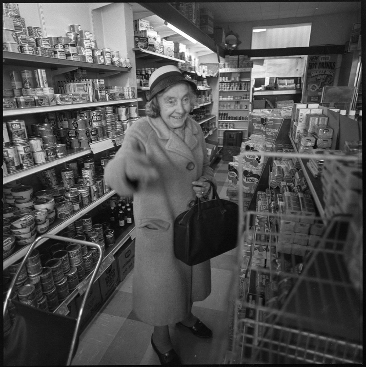 An elderly customer gets to grips with the new self-service supermarket