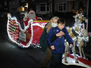 Santa in his sleigh as he turns up to see Cody Ralley at his home in Wednesbury. Cody is seen getting a hug from his grandmother Julie Corr.