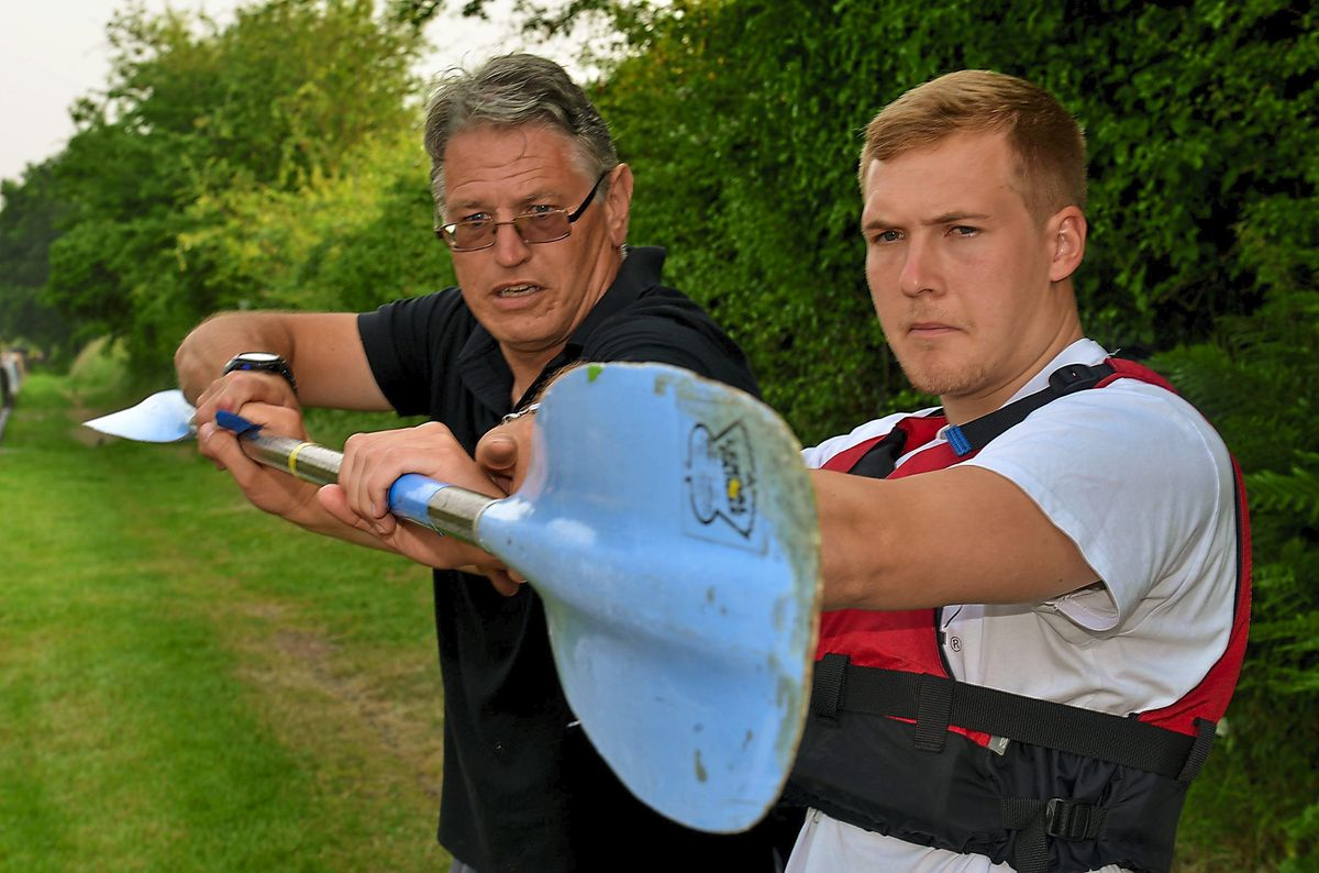 Jamie is shown how to use a paddle by coach Nigel Hargrave