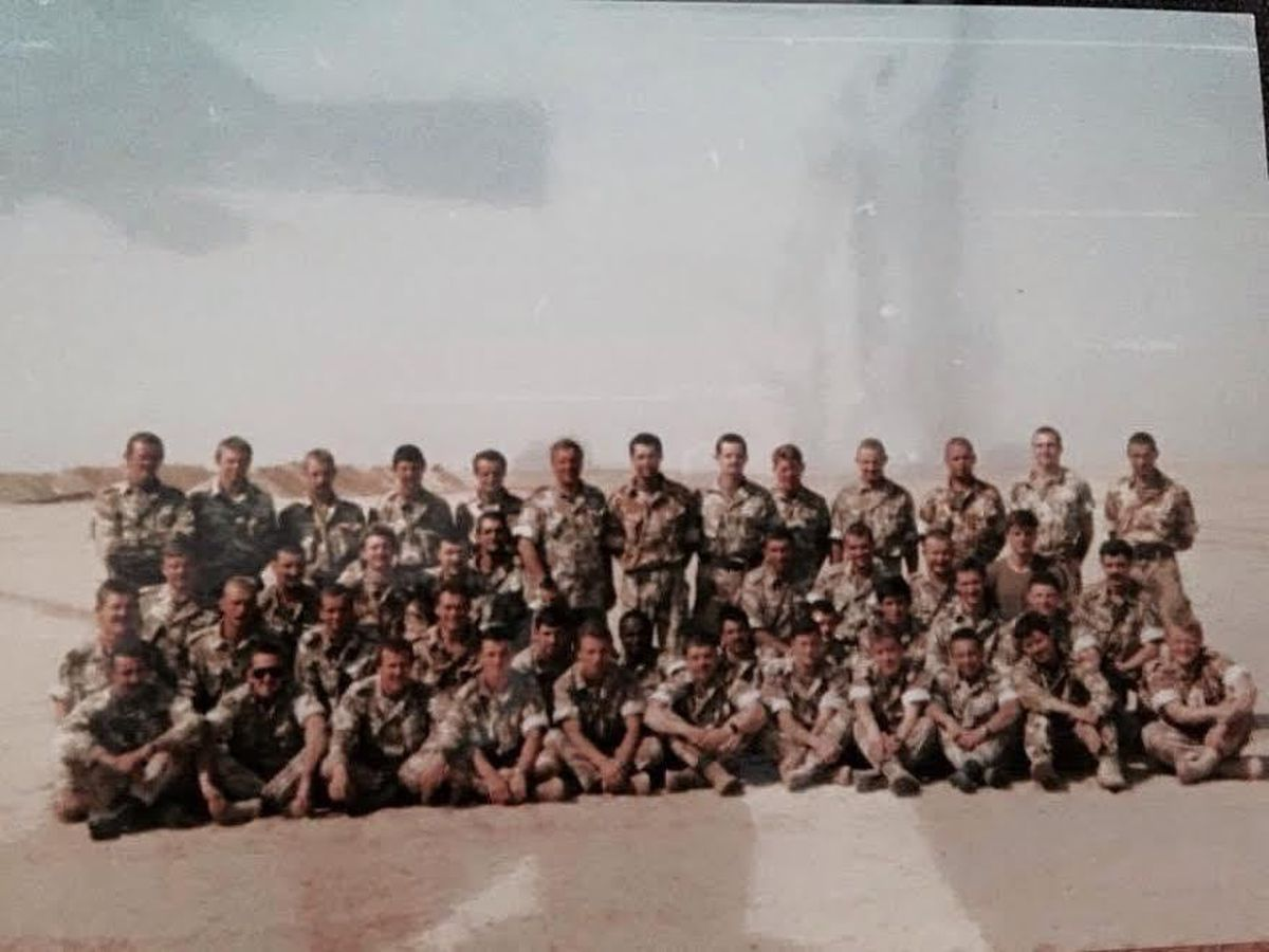 Keith Hodgson, back row, centre, with the signals platoon that was under his command