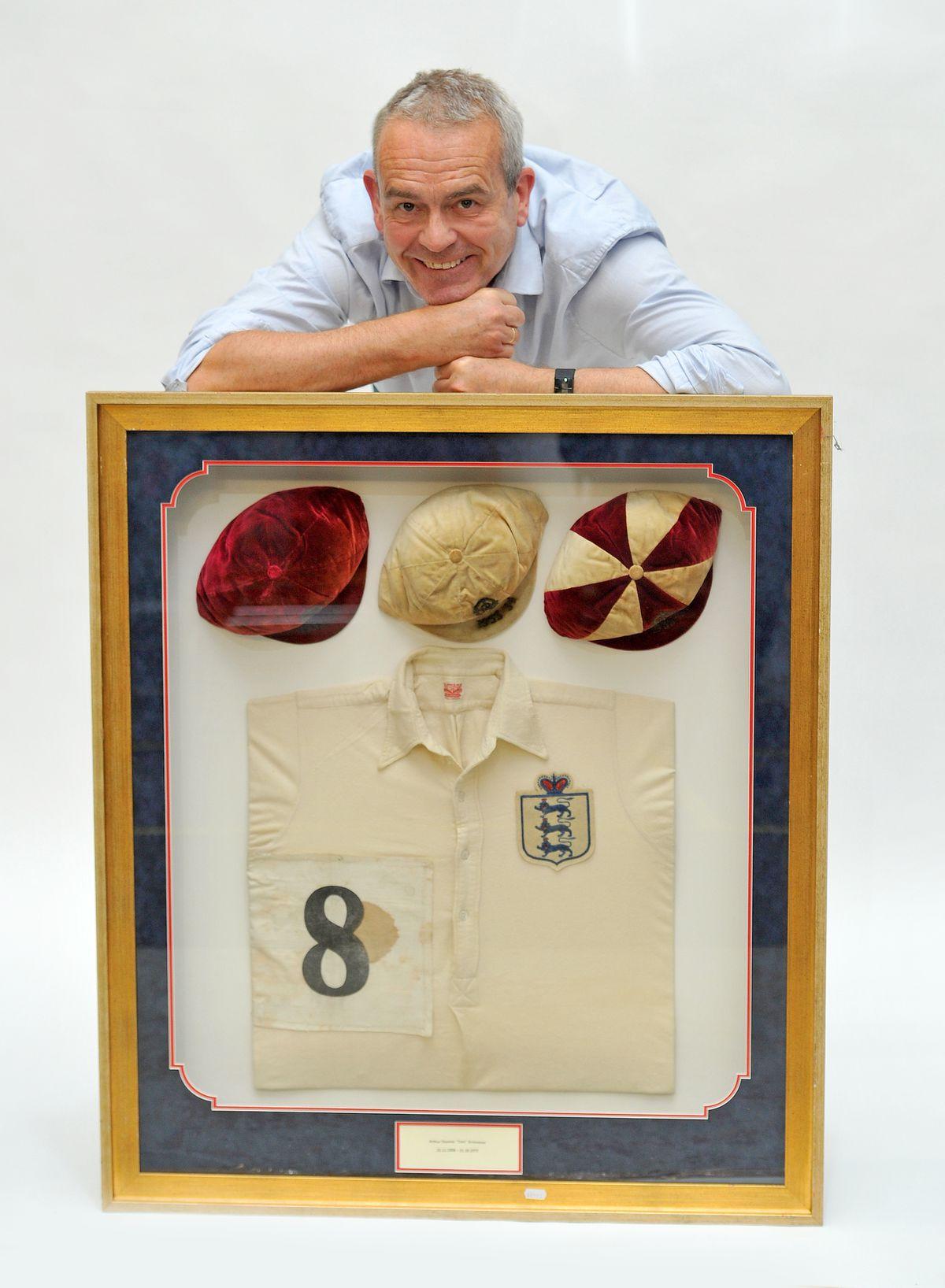 Nick Davies with Tom's shirt and caps