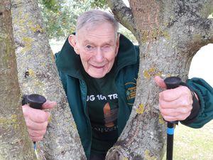 Bill Redston hugs a tree at the National Memorial Arboretum.