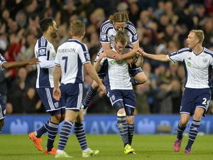 Chris Brunt of West Bromwich Albion celebrates after he scores a goal to make it 3-0 with Jonas Olsson of West Bromwich Albion.