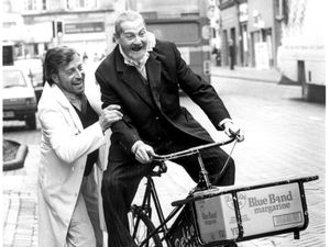 Actors Ken Farrington and David Ross larking about in Lichfield Street