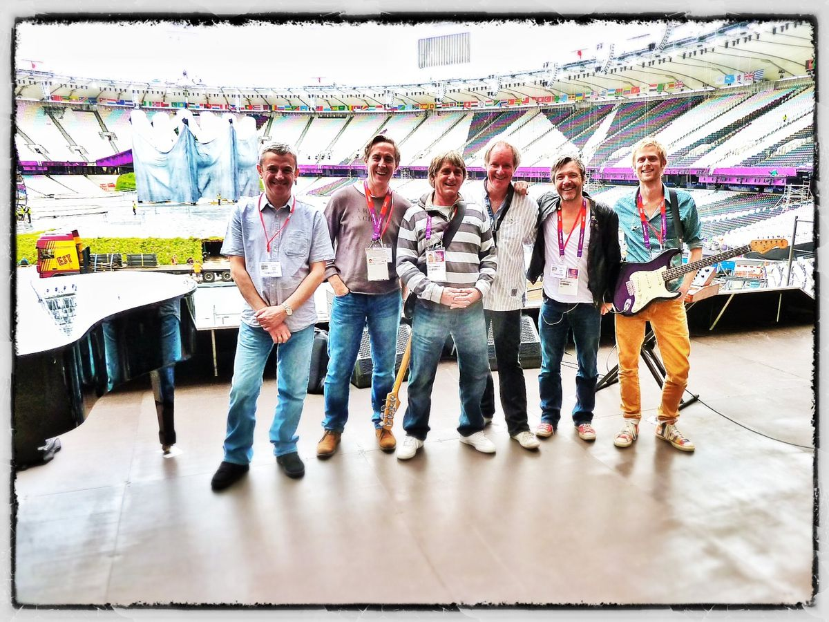 Luke, far right, with his dad, third from left, at the sound check for the London Olympics in 2012