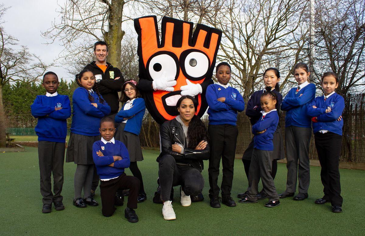 Shanaze Reade joins St Philip's School Catholic Primary School pupils and Strider, Living Streets mascot to celebrates the strides they've taken to get more active on the school run