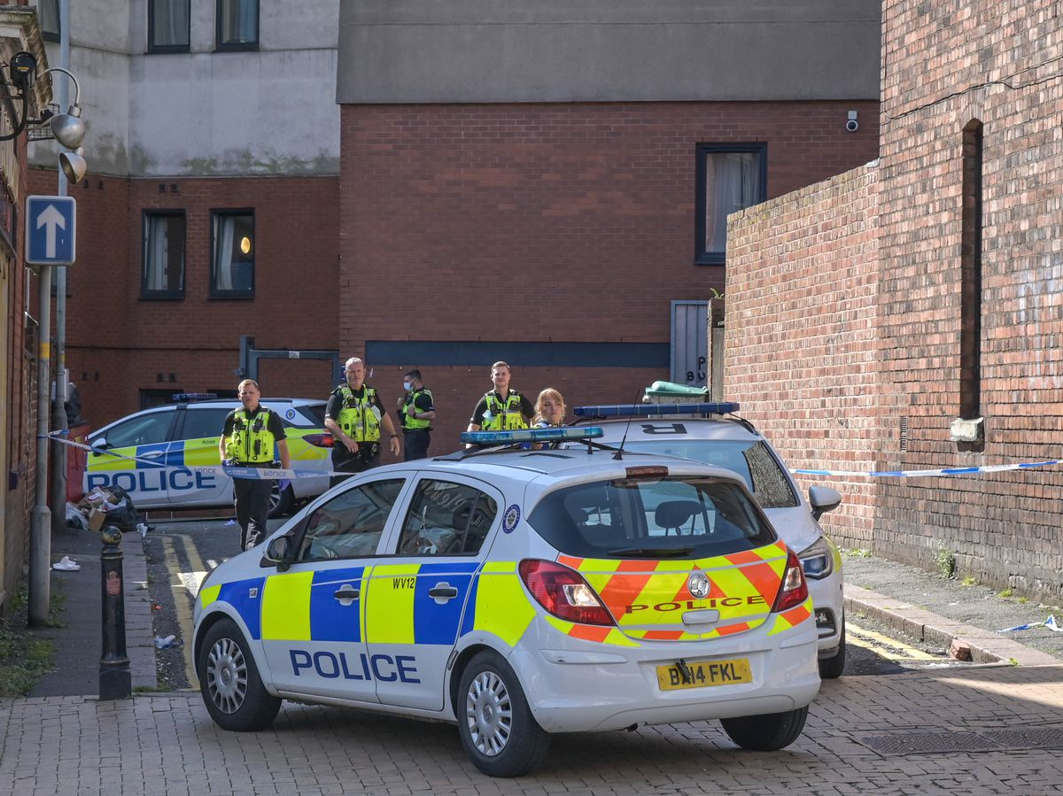 Police at the student accommodation in Lichfield Street, Wolverhampton, where a student fell from a window and died. Photo: SnapperSK