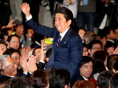 Japan's Shinzo Abe calls for revision of post-war constitution after staying in post