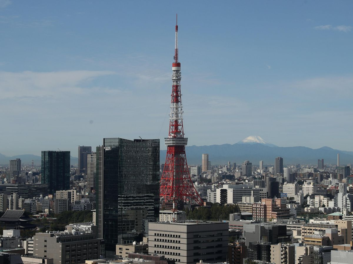 The Tokyo Tower with Mount Fuji in the distance (David Davies/PA)
