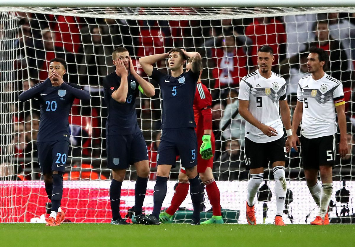 Jesse Lingard (left), Eric Dier and John Stones (centre) react after a missed chance.