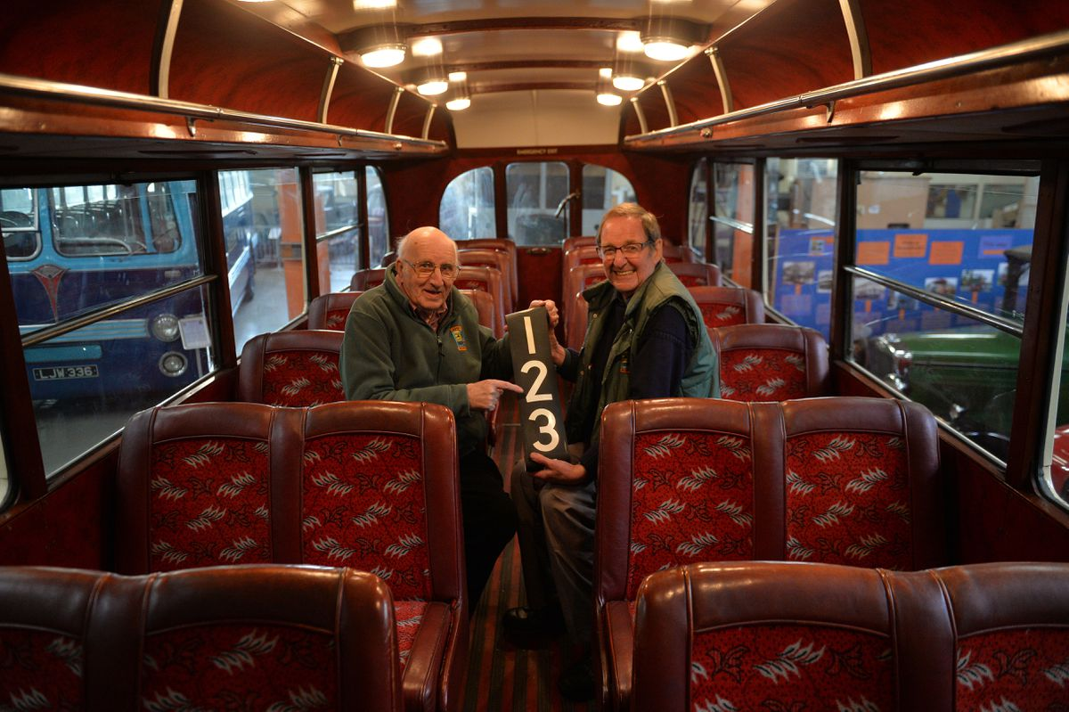 Alan Bishop and Martin Fisher celebrate the accolade on a 1940 SON Midland Red bus