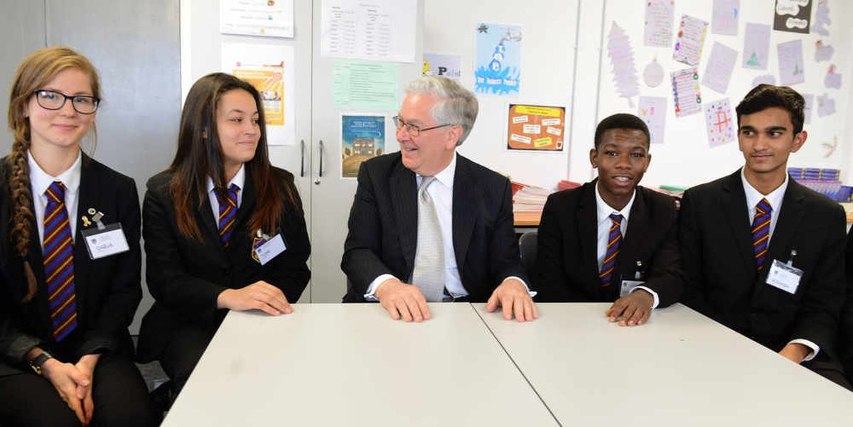 Former Governor of Bank of England Lord Mervyn King, talks to pupils at Colton Hills School, Wolverhampton.