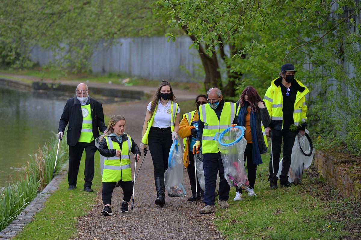 Ellie worked with volunteers to help clean up the canal