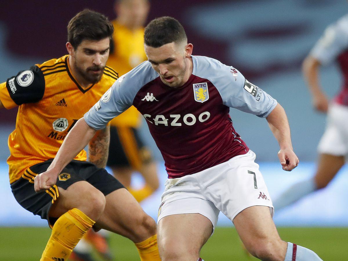 John McGinn of Aston Villa and Ruben Neves of Wolverhampton Wanderers.