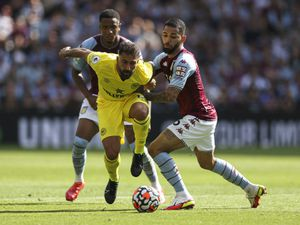 """Brentford's Saman Ghoddos (left) and Aston Villa's Douglas Luiz (right) battle for the ball during the Premier League match at Villa Park, Birmingham. Picture date: Saturday August 28, 2021. PA Photo. See PA story SOCCER Villa. Photo credit should read: Barrington Coombs/PA Wire.    RESTRICTIONS: EDITORIAL USE ONLY No use with unauthorised audio, video,  data, fixture lists, club/league logos or """"live"""" services. Online in-match use limited to 120 images, no video emulation. No use in betting, games or single club/league/player publications."""