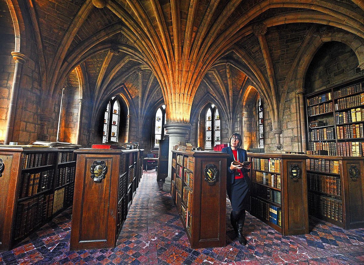Library manager Clare Townsend in the impressive library room at Lichfield Cathedral