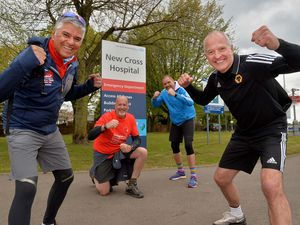 Steve Bull, Jason Guy, Neil Taylor and Suresh Bawa from Promise Dreams after completing a walk from Birmingham Childrens Hospital to New Cross Hospital, raising money for both hospitals and also Promise Dreams.