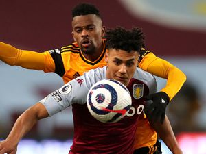 "Aston Villa's Ollie Watkins and Wolverhampton Wanderers' Nelson Semedo battle for the ball during the Premier League match at Villa Park, Birmingham. Picture date: Saturday March 6, 2021. PA Photo. See PA story SOCCER Villa. Photo credit should read: Peter Cziborra/PA Wire.   RESTRICTIONS: EDITORIAL USE ONLY No use with unauthorised audio,  video, data, fixture lists, club/league logos or ""live"" services. Online in-match use limited to 120 images, no video emulation. No use in betting, games or single club/league/player publications."