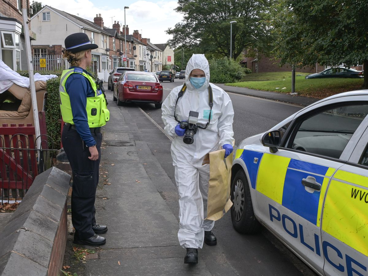 Investigators at the scene in Hordern Road on Sunday. Photo: SnapperSK