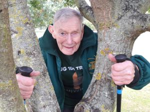 D-Day veteran Bill Redston hugged 100 trees at the National Memorial Arboretum in aid of charity. Photo: Rainforest Trust UK