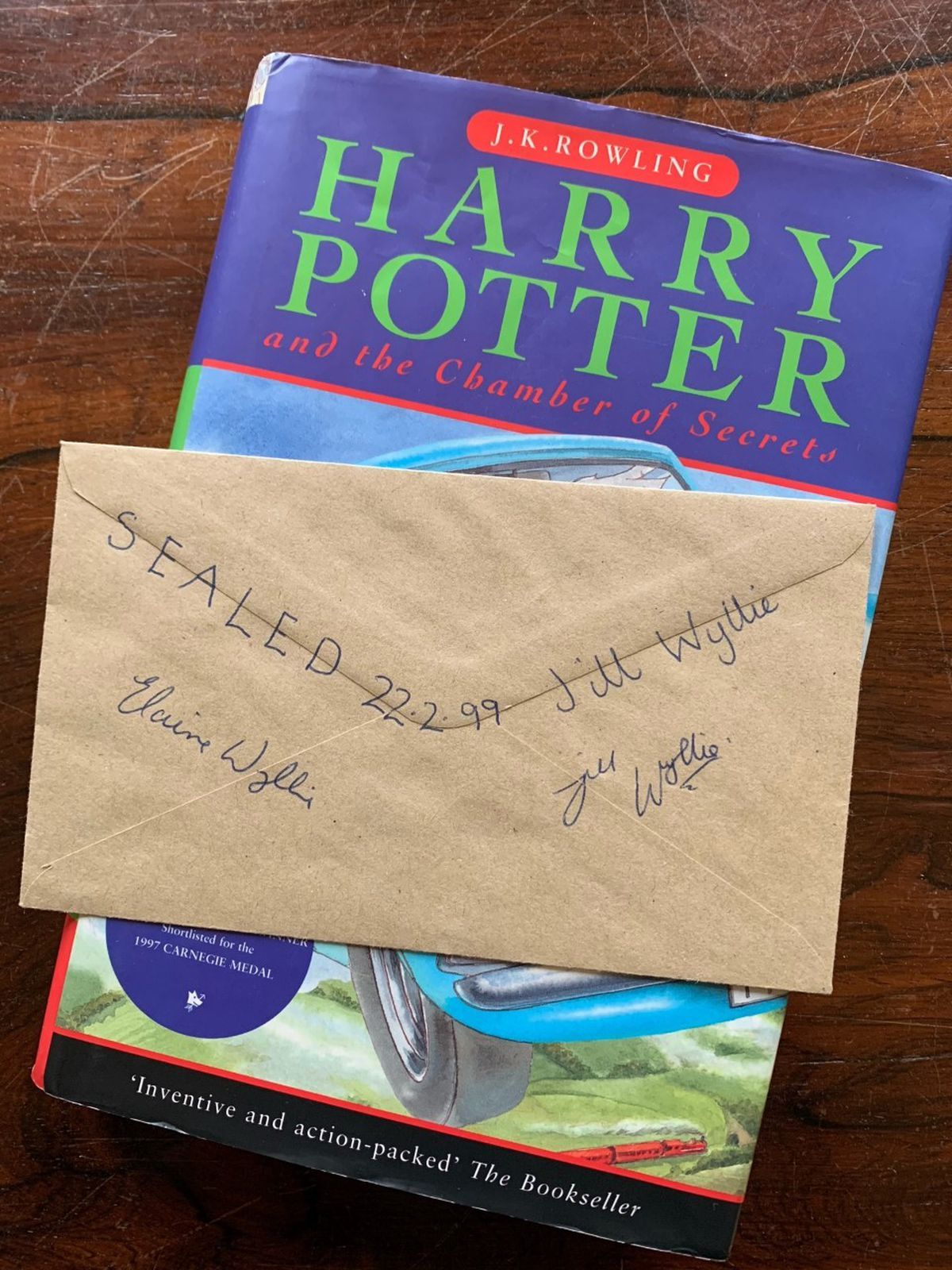 A signed copy of Chamber of Secrets and envelope relating to a meeting with JK Rowling in Dunblane, Scotland in 1999. Photo Hansons