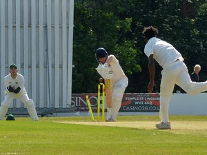 SPORT COPYRIGHT EXPRESS AND STAR STEVE LEATH 26/06/2021..Pics at Wolverhampton Cricket Club where they were playing Pelsall. Pelsall Bowling, and here Baz ( Saidrian Ward), jumps for joy after getting out: Charlie Mackleworth..
