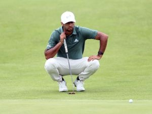 England's Aaron Rai lines up a putt on the 2nd green during day one of The Open at The Royal St George's Golf Club in Sandwich, Kent. Picture date: Thursday July 15, 2021. PA Photo. See PA story GOLF Open. Photo credit should read: David Davies/PA Wire.   RESTRICTIONS: Editorial use only. No  commercial use. Still image use only. The Open Championship logo and clear link to The Open website (TheOpen.com) to be included on website publishing