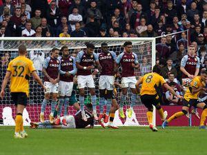 Wolverhampton Wanderers' Ruben Neves sees his free kick deflect off Aston Villa's Matt Targett (right) resulting in the winning goal