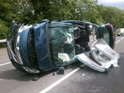 Pensioner cut free as car flips in Stafford crash