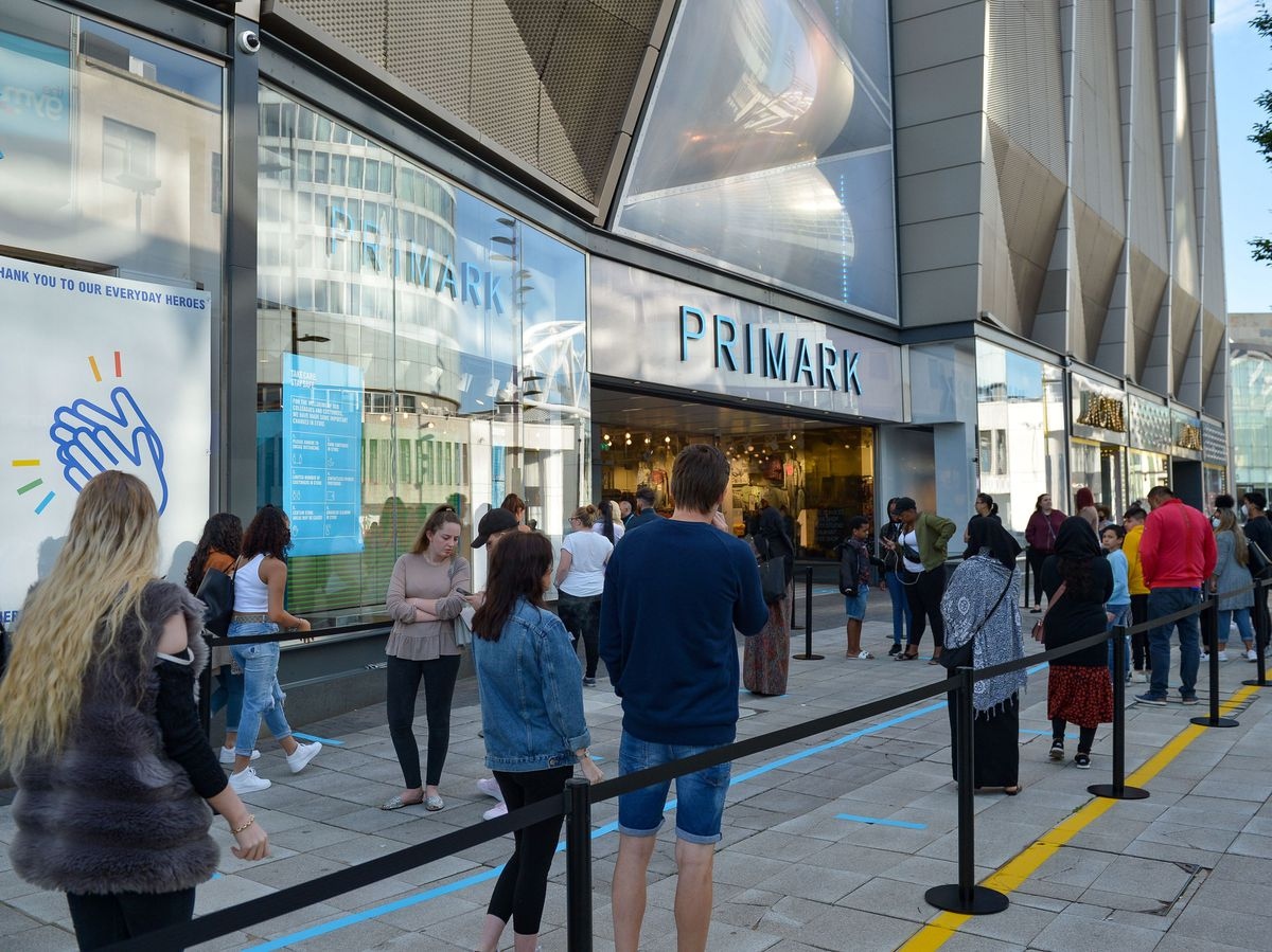 Hundreds of people queue at Primark in Birmingham which has reopened today