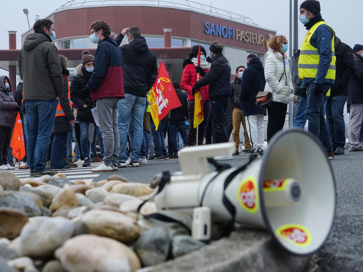 Striking workers gather outside the French pharmaceutical company Sanofi headquarters in Marcy l'Etoile