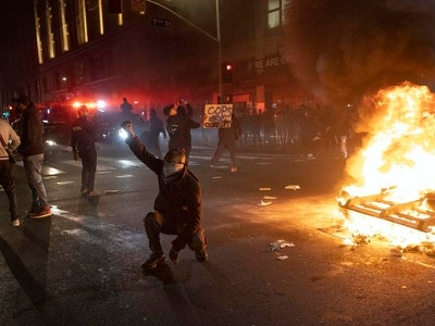 Thousands flout curfew as unrest spreads across US over death of George Floyd