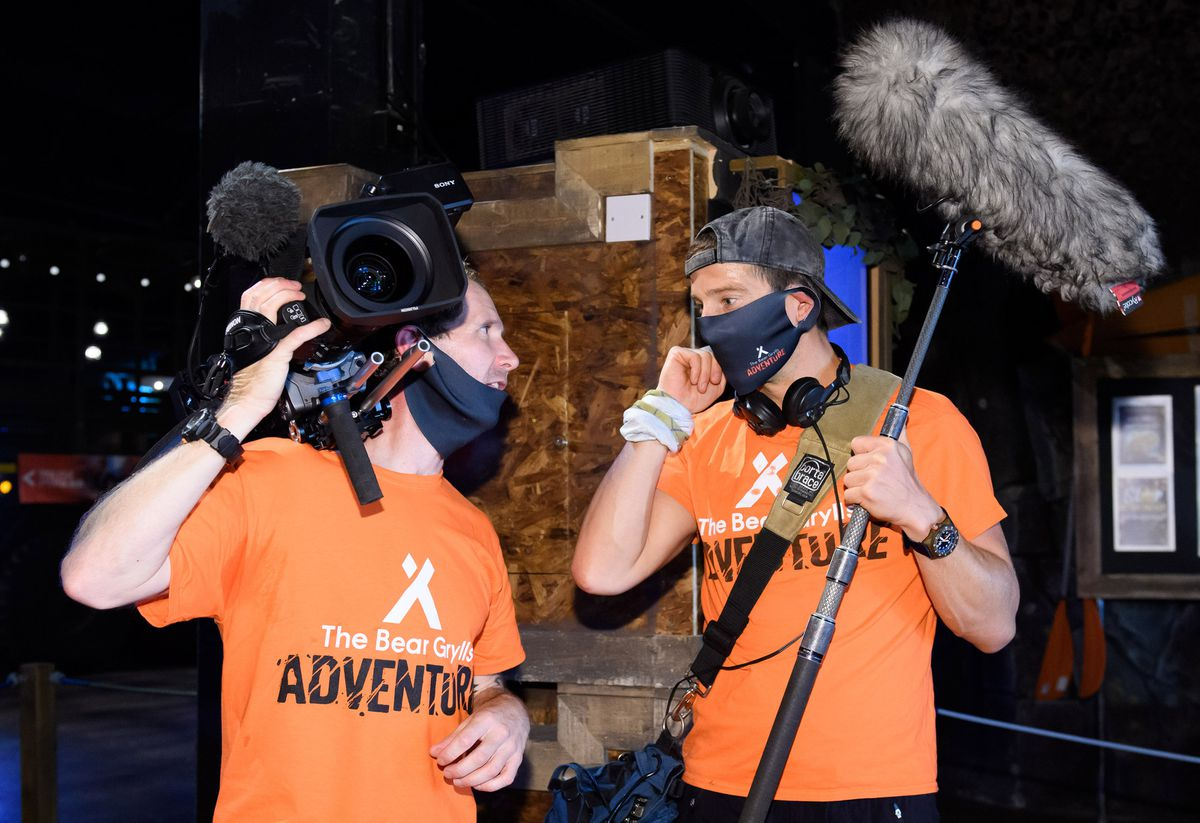 Bear Grylls dresses as a soundman to surprise vistiors