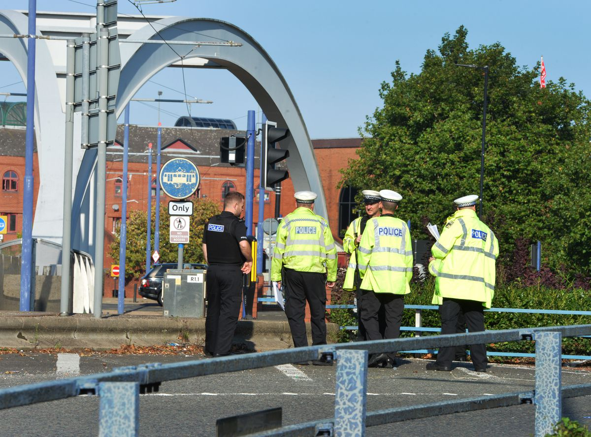 Police officers at the scene at the Bilston Street Island