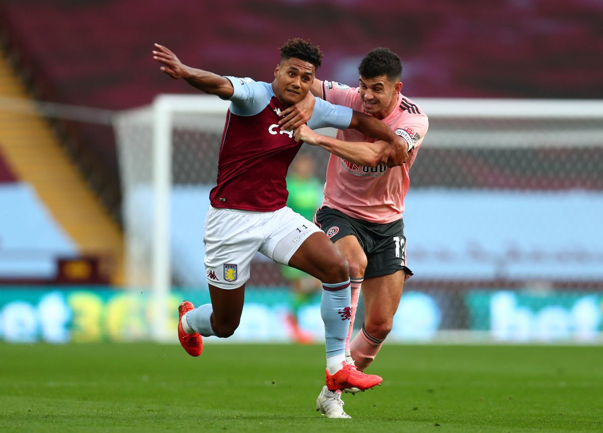 Sheffield United's John Egan holds back Aston Villa's Ollie Watkins resulting in a red card