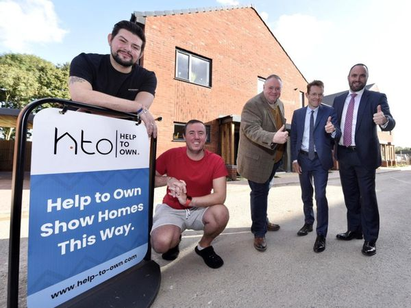 Tenants Timothy Perry and Aaron Parsons, with Councillor Steve Simkins, Andy Street and Sam Miller