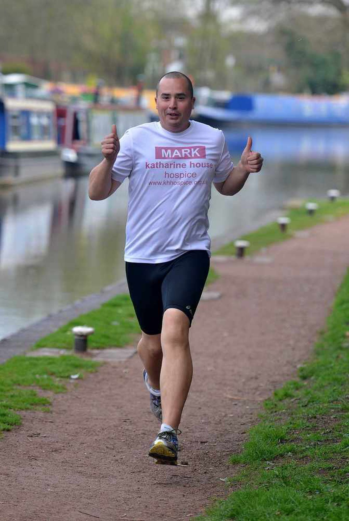 Mark Vaz strides out alongside the canal which will be one of his marathon distance runs