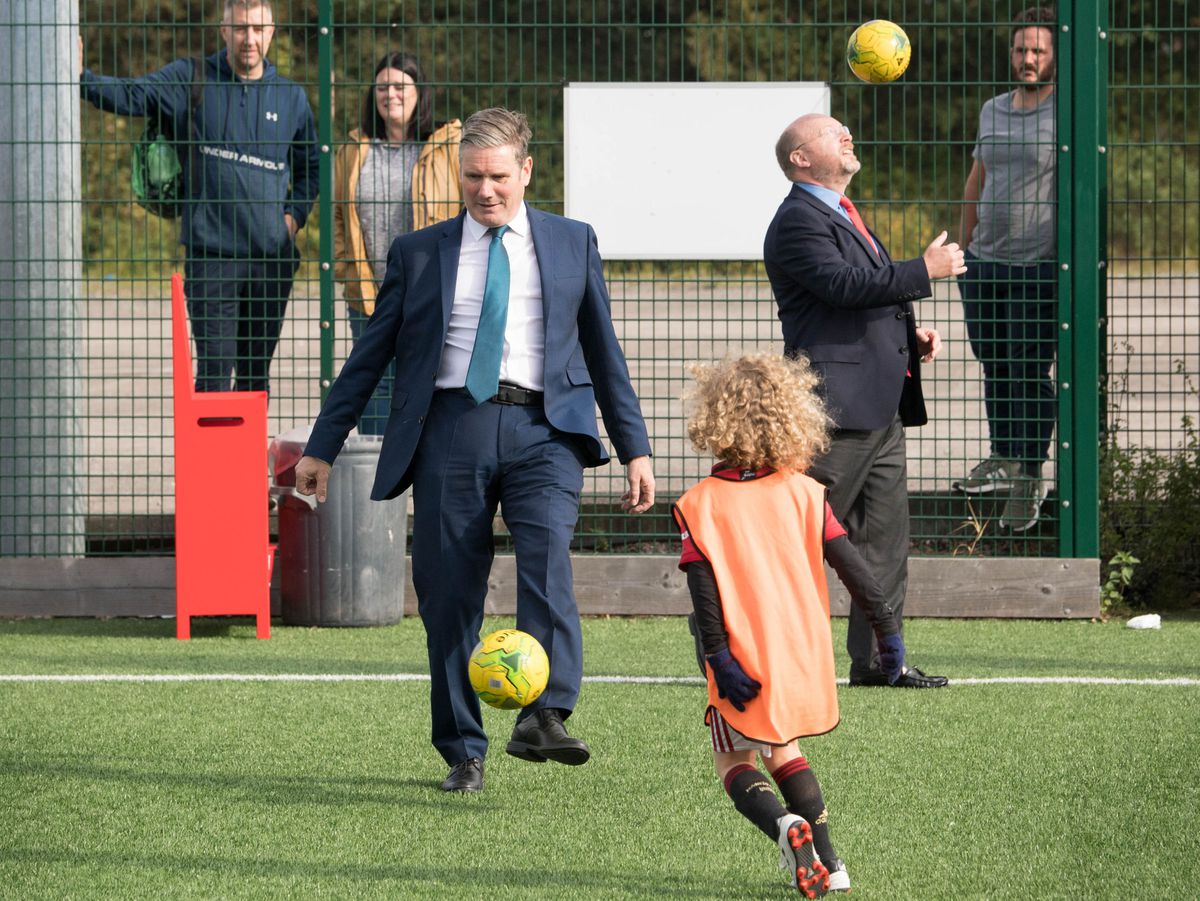 Labour leader Sir Keir Starmer (left) with MP Liam Byrne playing football during a visit to Walsall FC. Photo: Stefan Rousseau/PA Wire.