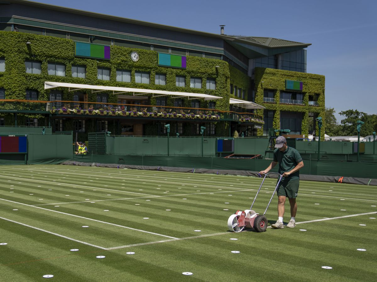 Lines are painted on the outside courts at Wimbledon
