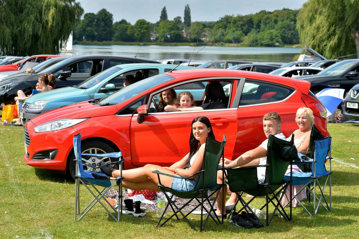 Families made themselves comfortable both inside and outside their cars