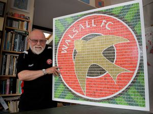 Stamp artist Pete Mason, who has created a pic of the Walsall FC logo in stamps, which he plans to give to the club, to wish them good luck before the new season begins