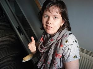 Lily Smith gives her new stairlift the thumbs up