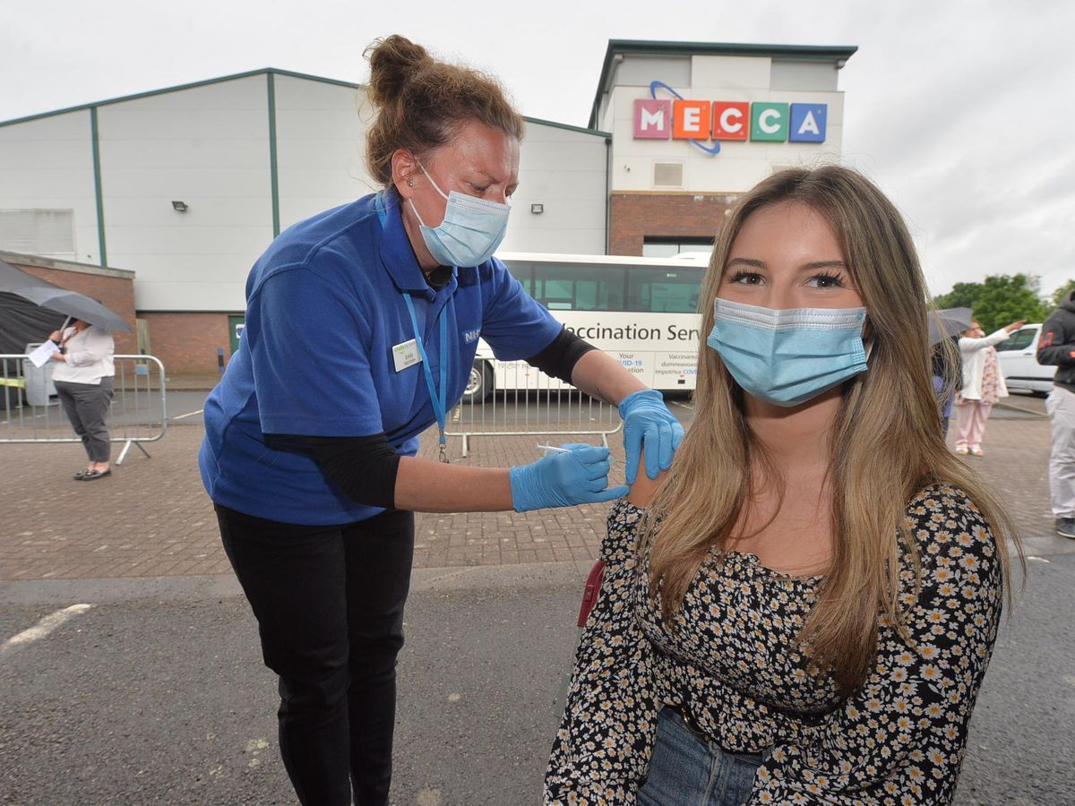 Emily Thompson from Bilston gives the Pfizer vaccine to Maddie Richardson