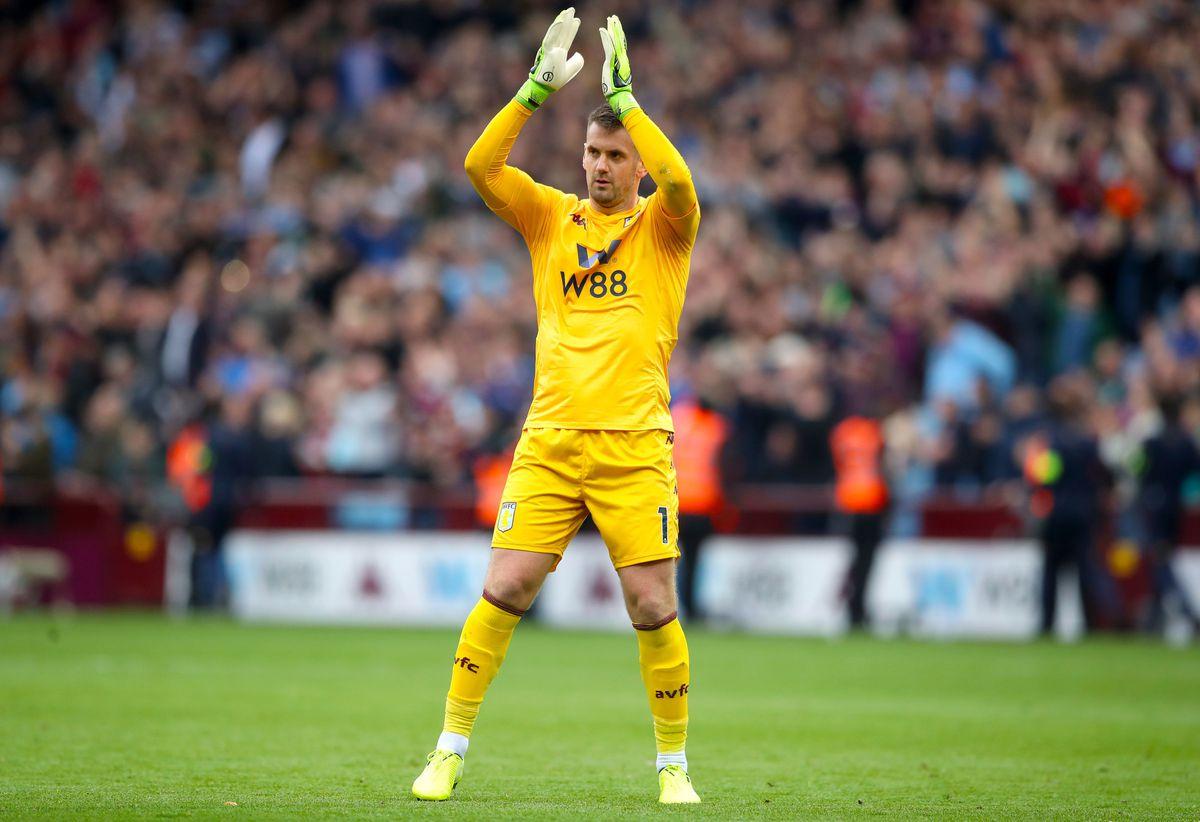 Aston Villa goalkeeper Tom Heaton applauds the fans