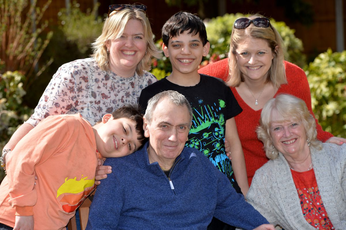 Leonard is pictured with wife Pat, grandchildren Adam and Jack and daughters Karen and Becky