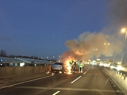 Car bursts into flames on the M5 causing rush hour misery for drivers