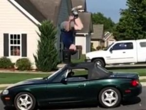 Wesley Williams jumping onto and over a vending machine and a car