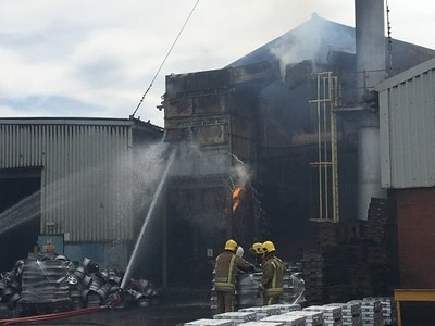 Thirty firefighters tackle Norton Canes factory blaze - WATCH