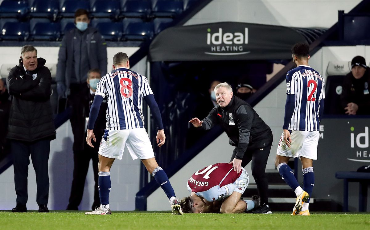West Bromwich Albion's Jake Livermore reacts after tackling Aston Villa's Jack Grealish