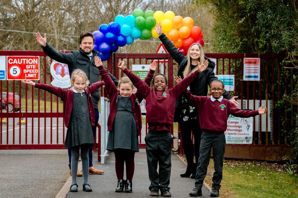 Woodthorne Primary School headteacher Tom Hinkley with Miss Sophie Watts, Rosie Birch, Arna Donoway, Caesar Robertson-Ellis and Amanda Shakes